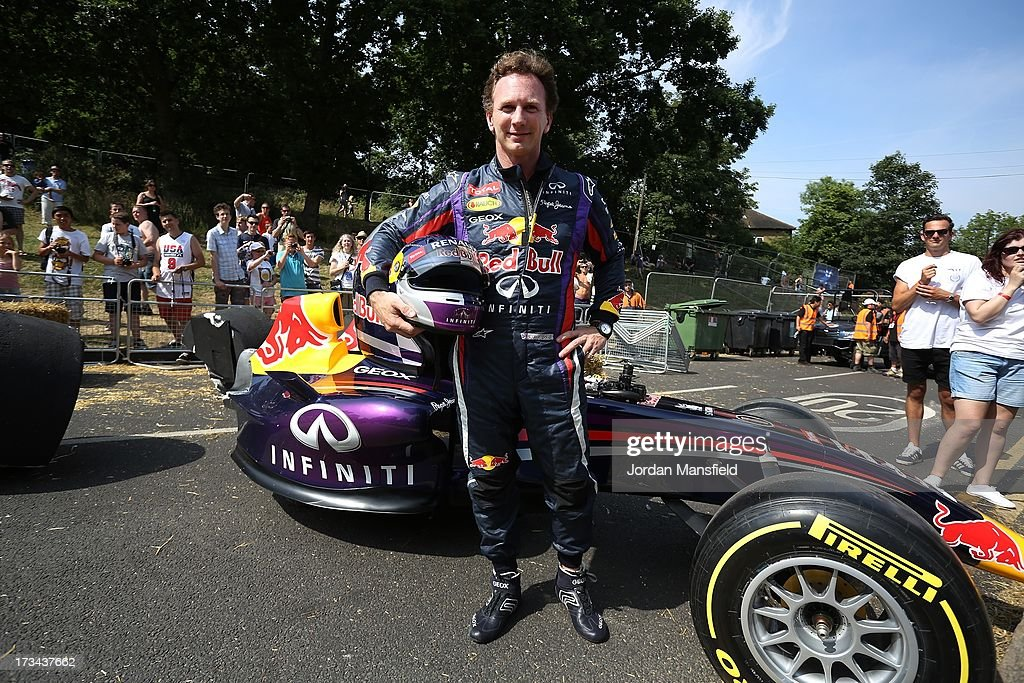 <a gi-track='captionPersonalityLinkClicked' href=/galleries/search?phrase=Christian+Horner&family=editorial&specificpeople=228706 ng-click='$event.stopPropagation()'>Christian Horner</a>, Team Principal of the Infiniti Red Bull Racing Formula One team, poses for a photo with the Red Bull racing soapbox racer after completing the course during the Red Bull Soapbox Race at Alexandra Palace on July 14, 2013 in London, England. The Red Bull Soapbox Race returned to London after nine years and encourages competitors to build and race their own homemade soapboxes down a hill.