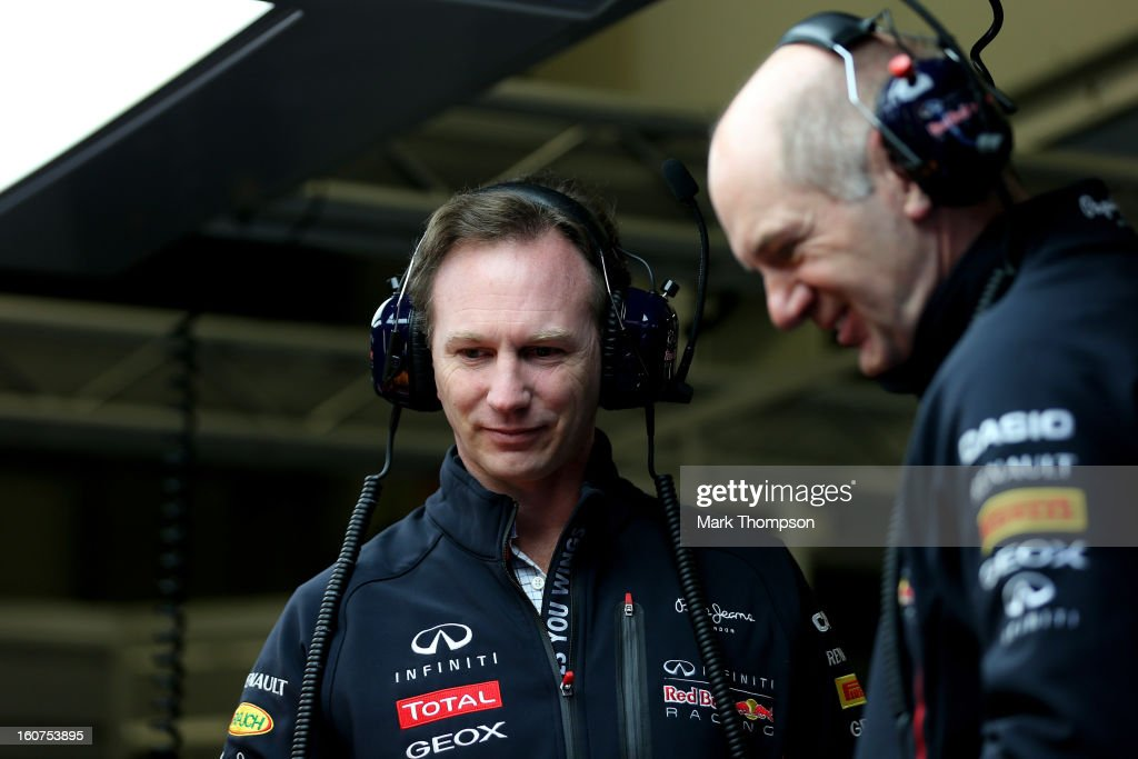 Christian Horner the Team Principal of Red Bull Racing talks to Adrian Newey the Chief Technical Officer of Red Bull Racing in the garage during Formula One winter testing at Circuito de Jerez on February 5, 2013 in Jerez de la Frontera, Spain.