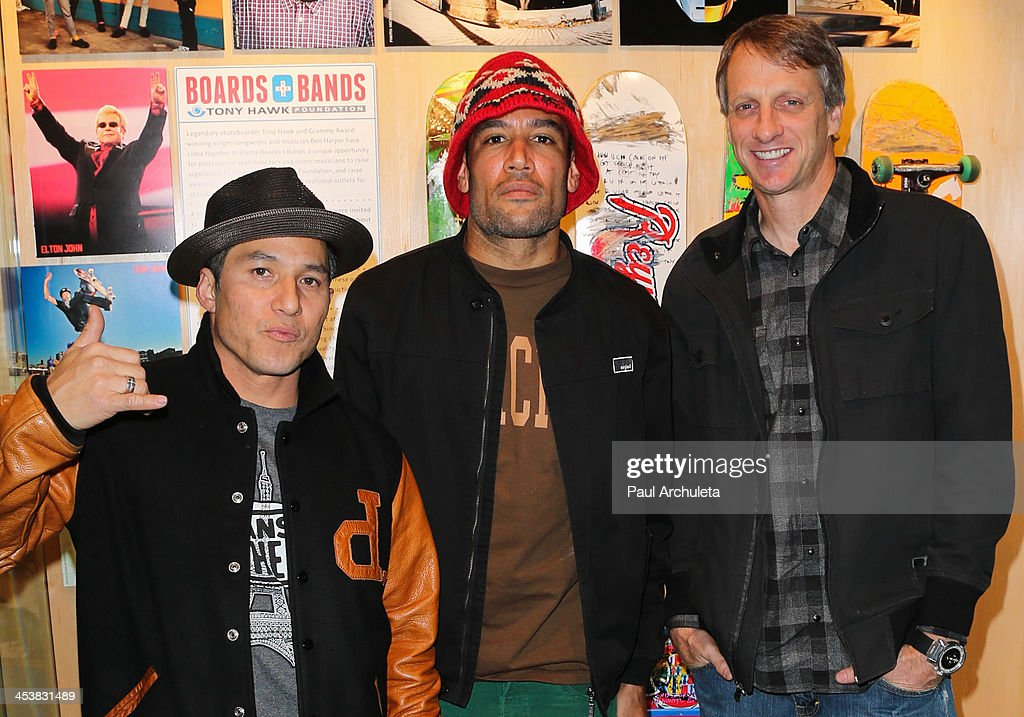 Christian Hosoi Ben Harper and Tony Hawk attend the press conference for Boards Bands Auction at The GRAMMY Museum on December 5 2013 in Los Angeles...