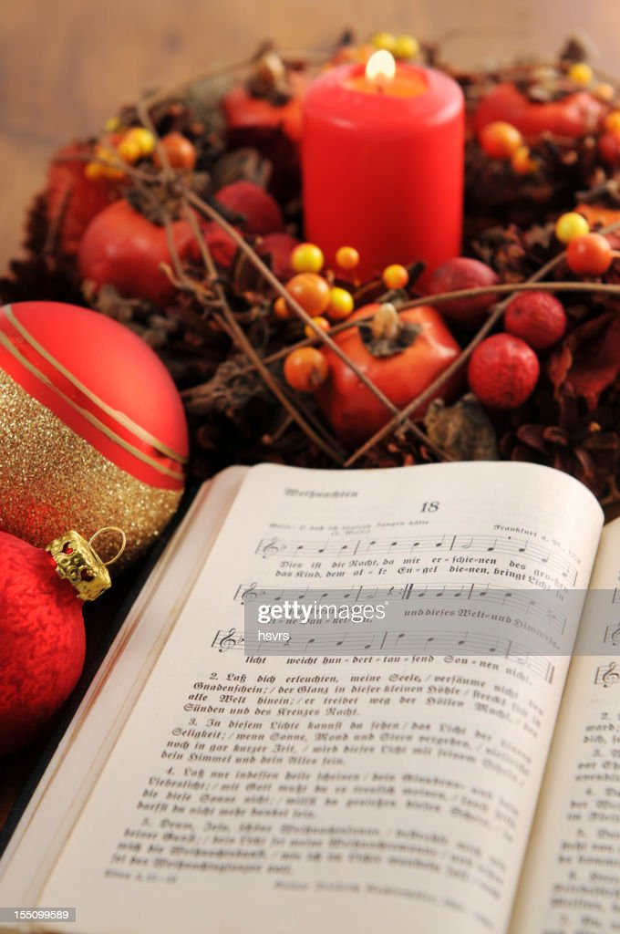 christian hymnal book with christmas wreath and balls