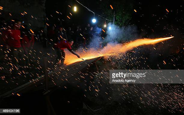 Christian ignites homemade rockets at 'Rocket War' during Greek Orthodox Easter celebrations in the town of Vrontados on the Greek island of Chios on...