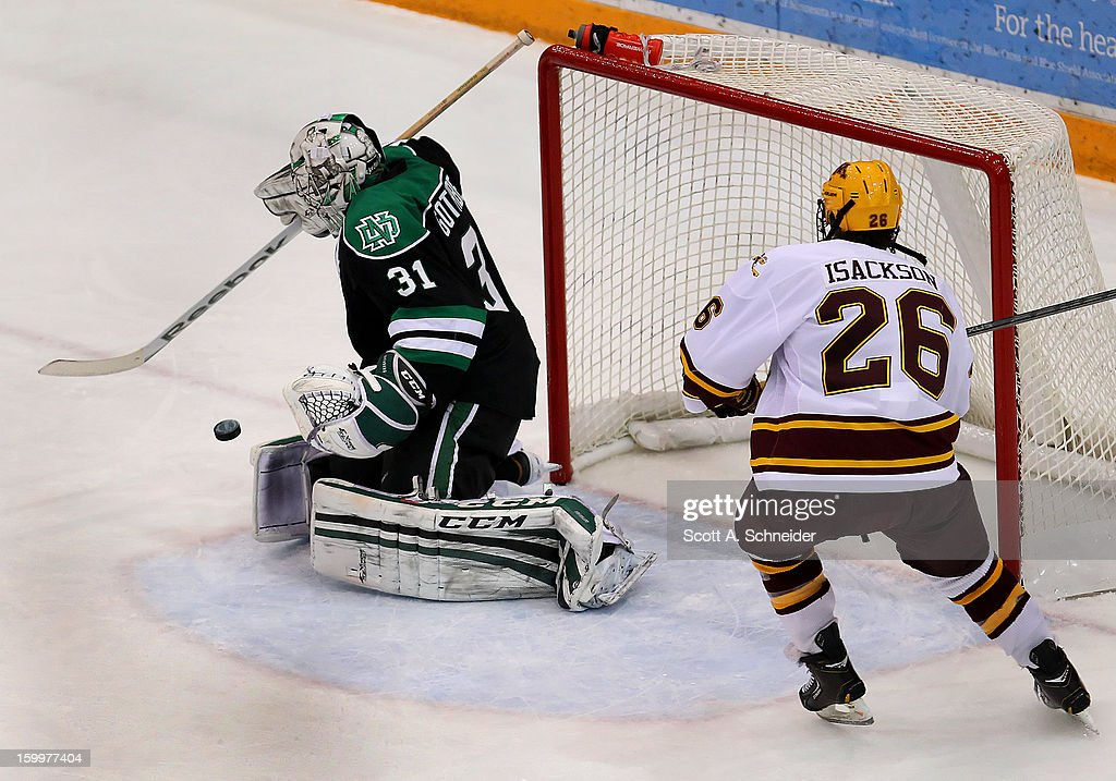 Christian Isackson #26 of Minnesota looks for the rebound after a save by Zane Gothberg #31 of North Dakota January 19, 2013 at Mariucci Arena in Minneapolis, Minnesota.