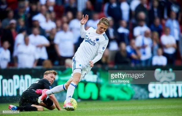 Christian Jakobsen of Sonderjyske and Kasper Kusk of FC Copenhagen compete for the ball during the Danish Alka Superliga match between FC Copenhagen...
