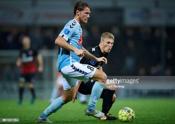 Christian Jakobsen of Sonderjyske and Rasmus Nissen of FC Midtjylland compete for the ball during the Danish Alka Superliga match between Sonderjyske...