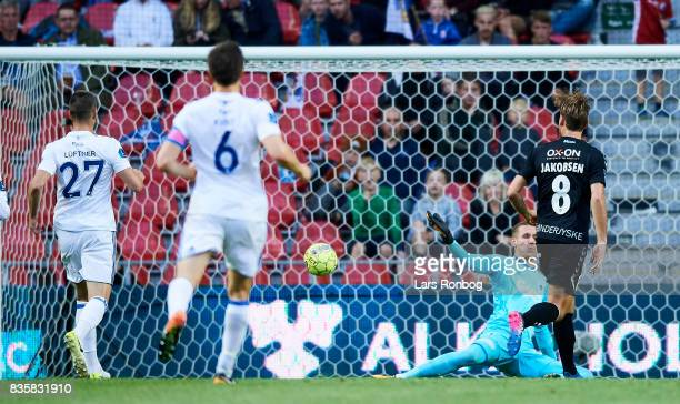 Christian Jakobsen of Sonderjyske scores the 11 goal against Goalkeeper Robin Olsen of FC Copenhagen during the Danish Alka Superliga match between...