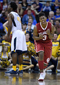 Christian James of the Oklahoma Sooners reacts after a foul was called on the West Virginia Mountaineers in the second half during the semifinals of...