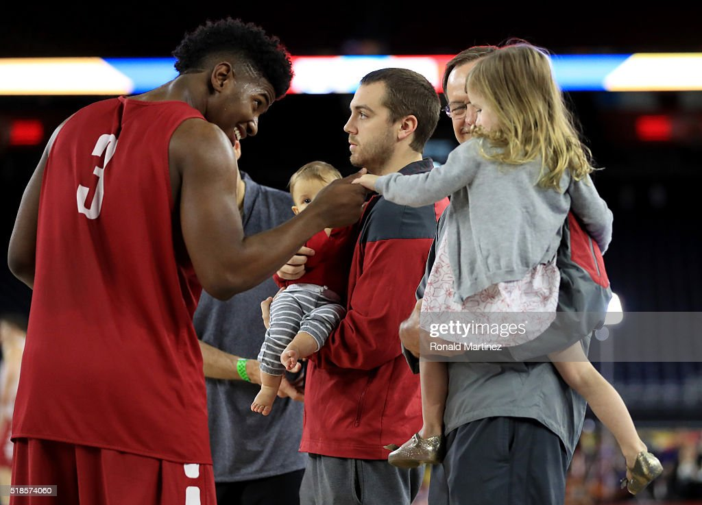 Christian James #3 of the Oklahoma Sooners talks with Avery Ciklin as she is being held by her grandfather head coach <a gi-track='captionPersonalityLinkClicked' href=/galleries/search?phrase=Lon+Kruger&family=editorial&specificpeople=642672 ng-click='$event.stopPropagation()'>Lon Kruger</a> of the Sooners during a practice session for the 2016 NCAA Men's Final Four at NRG Stadium on April 1, 2016 in Houston, Texas.
