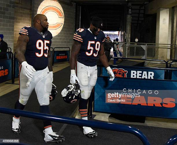 Christian Jones of the Chicago Bears and Ego Ferguson go to the locker room after the game against the Dallas Cowboys on December 4 2014 at Soldier...