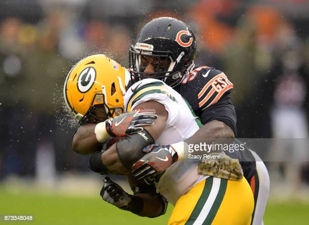 Christian Jones of the Chicago Bears hits Ty Montgomery of the Green Bay Packers in the second quarter at Soldier Field on November 12 2017 in...