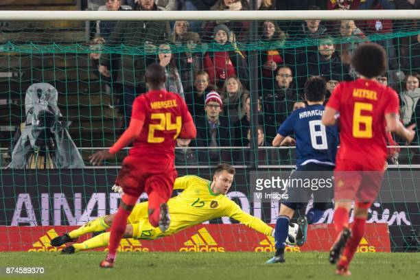 Christian Kabasele of Belgium goalkeeper Simon Mignolet of Belgium Genki Haraguchi of Japan Axel Witsel of Belgium during the friendly match between...