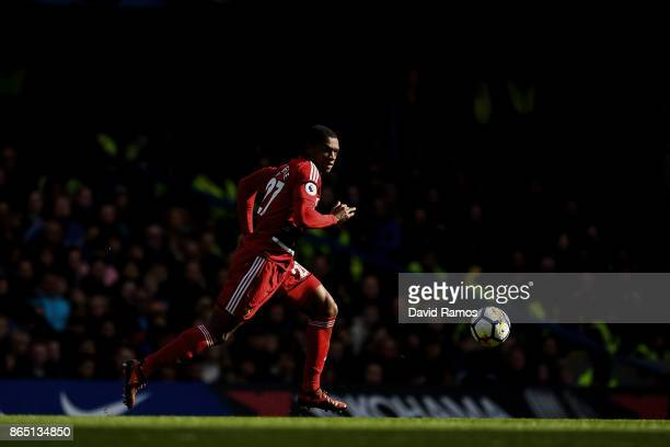 Christian Kabasele of Watford runs with the ball during the Premier League match between Chelsea and Watford at Stamford Bridge on October 21 2017 in...