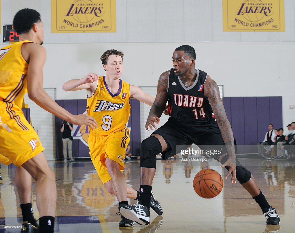 Christian Kabongo of the Idaho Stampede drives to the basket against Josh Magette of the Los Angeles DFenders on December 21 2013 at Toyota Sports...
