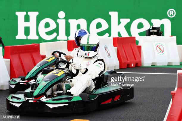 Christian Karembeu and David Coulthard compete in a karting event during previews for the Formula One Grand Prix of Italy at Autodromo di Monza on...