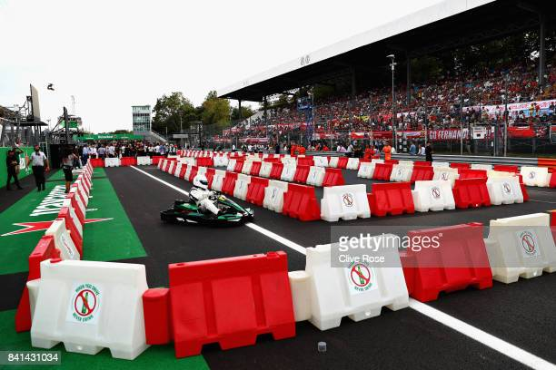 Christian Karembeu competes at a karting event during previews for the Formula One Grand Prix of Italy at Autodromo di Monza on August 31 2017 in...