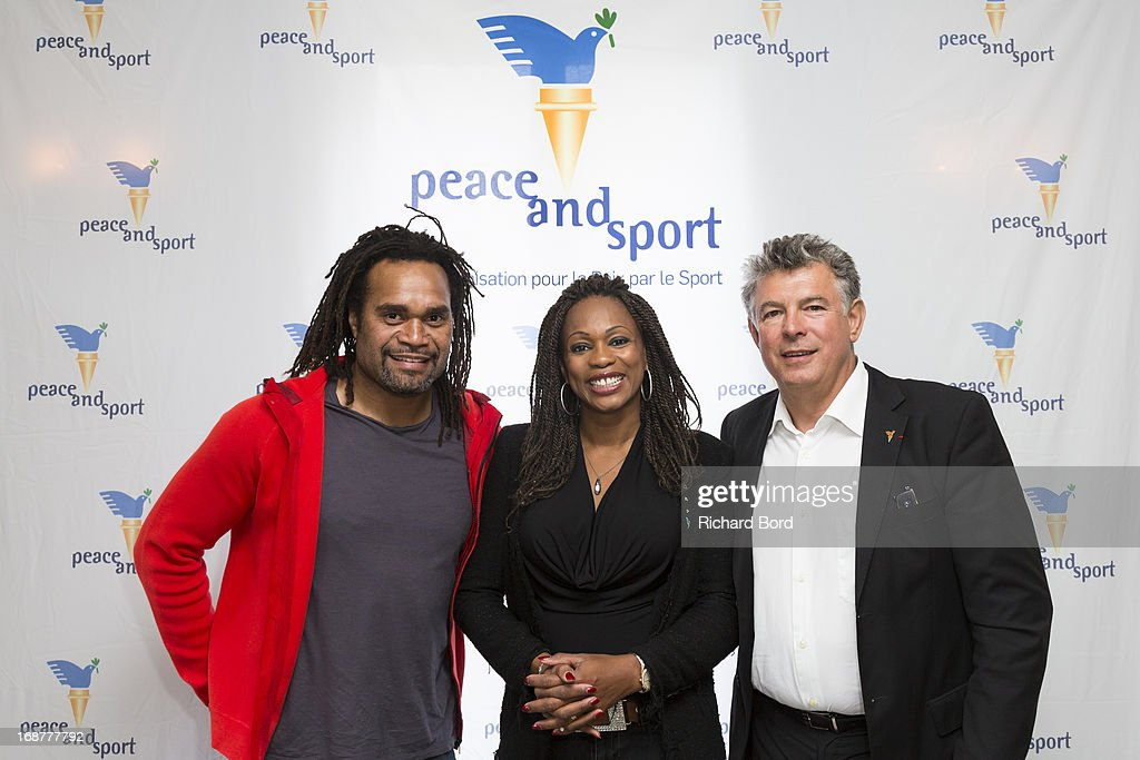 <a gi-track='captionPersonalityLinkClicked' href=/galleries/search?phrase=Christian+Karembeu&family=editorial&specificpeople=228704 ng-click='$event.stopPropagation()'>Christian Karembeu</a>, Laura Flessel and 'Peace and Sport' president <a gi-track='captionPersonalityLinkClicked' href=/galleries/search?phrase=Joel+Bouzou&family=editorial&specificpeople=3568857 ng-click='$event.stopPropagation()'>Joel Bouzou</a> pose during the 'Peace and Sport' France launch at Pavillon Ledoyen on May 15, 2013 in Paris, France.