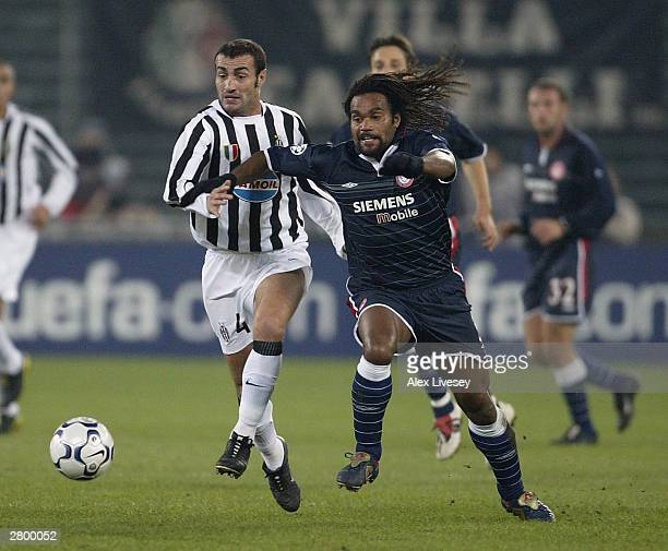 Christian Karembeu of Olympiakos beats Paolo Montero of Juventus during the UEFA Champions Group D match between Juventus and Olympiakos at Delle...