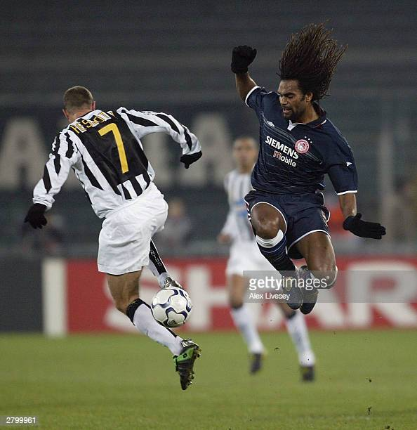 Christian Karembeu of Olympiakos tackles Gianluca Pessotto of Juventus during the UEFA Champions Group D match between Juventus and Olympiakos at...