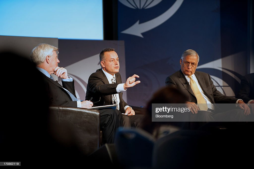 Christian Katz, chief executive officer of SIX Swiss Exchange Ltd., center, speaks as <a gi-track='captionPersonalityLinkClicked' href=/galleries/search?phrase=John+Manley&family=editorial&specificpeople=218008 ng-click='$event.stopPropagation()'>John Manley</a>, president and chief executive officer of the Canadian Council of Chief Executives (CCCE), left, and <a gi-track='captionPersonalityLinkClicked' href=/galleries/search?phrase=Shaukat+Aziz&family=editorial&specificpeople=555793 ng-click='$event.stopPropagation()'>Shaukat Aziz</a>, former prime minister of the Islamic Republic of Pakistan, listen during the International Economic Forum Of The Americas' Conference Of Montreal in Montreal, Quebec, Canada, on Monday, June 10, 2013. The Conference of Montreal brings together Heads of State, the private sector, international organizations and civil society to discuss major issues concerning economic globalization, focusing on the relations between the Americas and other continents. Photographer: David Vilder/Bloomberg via Getty Images