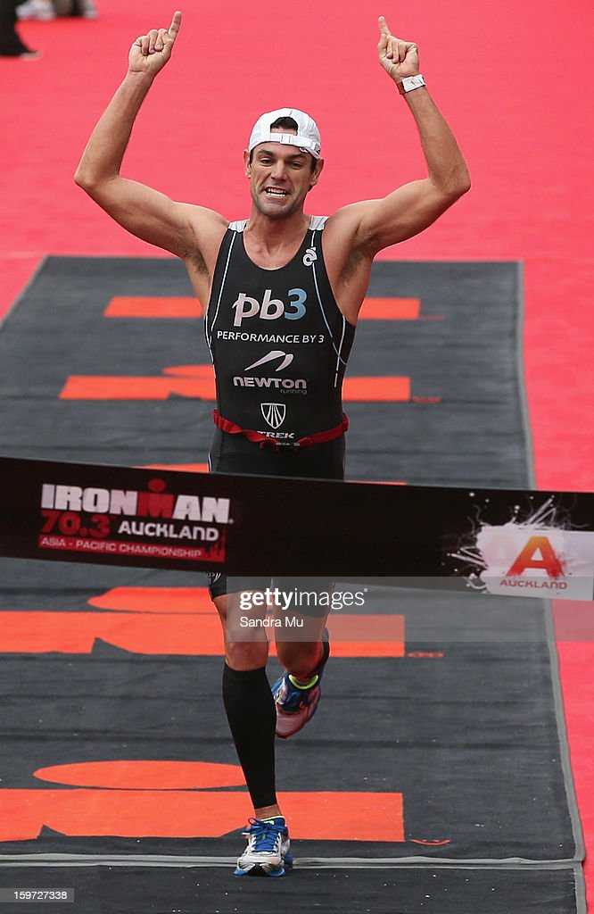 Christian Kemp of Australia celebrates winning the Ironman 70.3 Auckland triathlon on January 20, 2013 in Auckland, New Zealand.