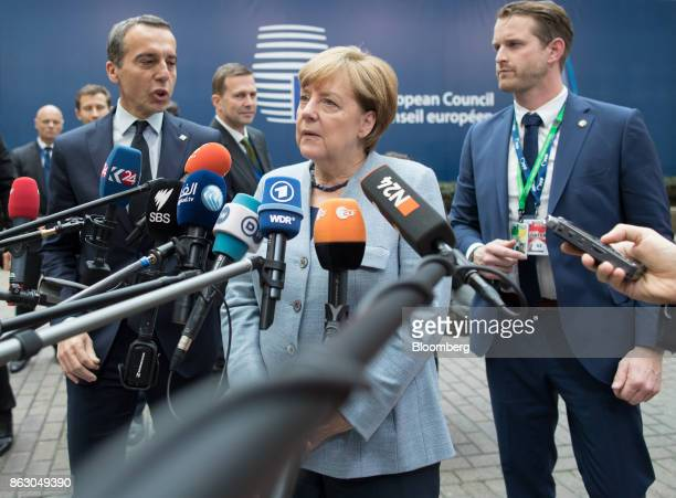 Christian Kern Austria's chancellor left speaks as Angela Merkel Germany's chancellor faces journalists as she arrives for a meeting of European...