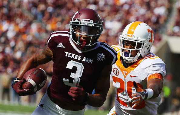 Christian Kirk of the Texas AM Aggies runs for a 13 yard touchdown past Evan Berry of the Tennessee Volunteers in the first half of their game at...