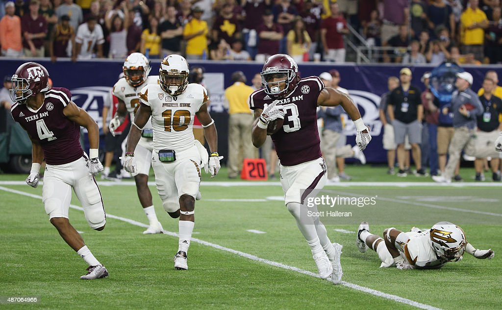 Christian Kirk of the Texas AM Aggies runs for a 66yard touchdown in the second half of their game against the Arizona State Sun Devils during the...