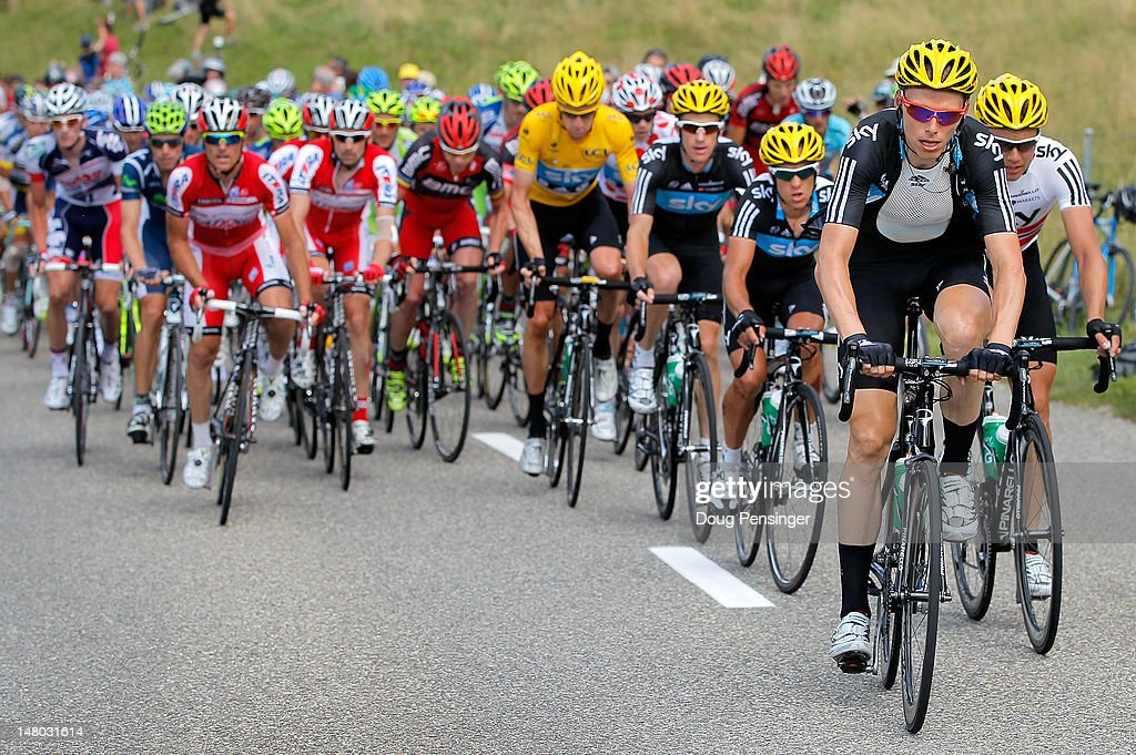 <a gi-track='captionPersonalityLinkClicked' href=/galleries/search?phrase=Christian+Knees&family=editorial&specificpeople=541153 ng-click='$event.stopPropagation()'>Christian Knees</a> of Germany leads the peloton for Sky Procycling as they defend the race leader's yellow jersey for <a gi-track='captionPersonalityLinkClicked' href=/galleries/search?phrase=Bradley+Wiggins&family=editorial&specificpeople=182490 ng-click='$event.stopPropagation()'>Bradley Wiggins</a> of Great Britain riding for Sky Procycling during stage eight of the 2012 Tour de France from Belfort, France to Porrentruy, Switzerland on July 8, 2012 in Mouillet, Switzerland.