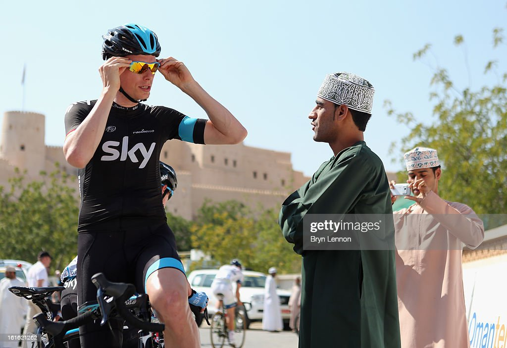 <a gi-track='captionPersonalityLinkClicked' href=/galleries/search?phrase=Christian+Knees&family=editorial&specificpeople=541153 ng-click='$event.stopPropagation()'>Christian Knees</a> of Germany talks to a local fan at the start of stage three of the 2013 Tour of Oman from Nakhal Fort to Wadi Dayqah Dam on February 13, 2013 in Nakhal Fort, Oman.