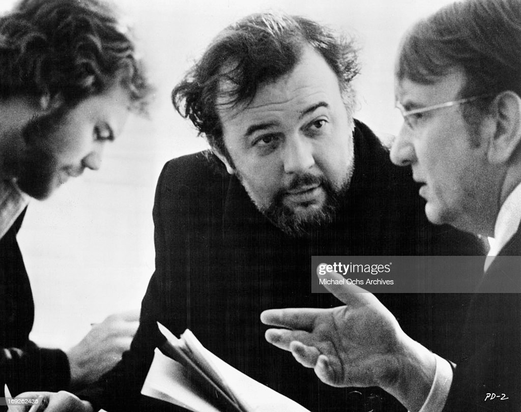 Christian Kohlund, Peter Hall and Alexander May investigate in a scene from the film 'The Pedestrian', 1973.