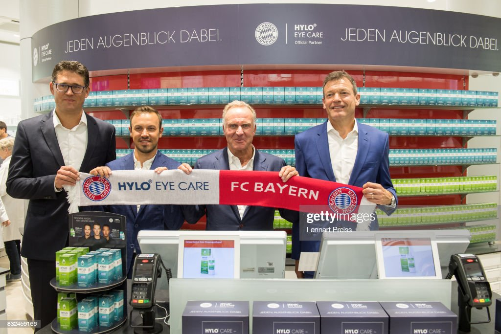 Christian Krensel (L-R), Global Director Marketing & Sales of Ursapharm, Dominik Holzer, CEO of Ursapharm, Karl-Heinz Rummenigge, CEO of FC Bayern Muenchen AG and Andreas Jung, Executive Board Member of FC Bayern Muenchen, pose for the photographers inside a pharmacy during the presentation of the new partnership of FC Bayern Muenchen and HYLO Eye Care on August 16, 2017 in Munich, Germany.