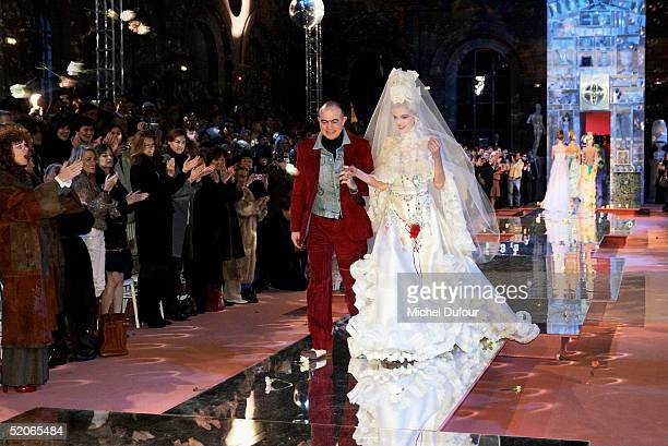 Christian Lacroix and the bride walk down the runway at the Christian Lacroix fashion show as part of Paris Fashion Week Spring/Summer 2005 on...