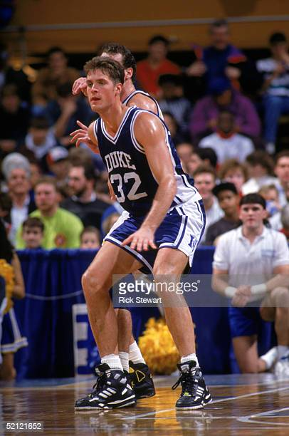 Christian Laettner of the Duke University Blue Devils battles for position during an NCAA game against Canisius College on December 7 1991 at the...