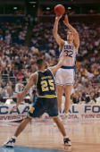 Christian Laettner of the Duke University Blue Devils shoots a jump shot during a game in the NCAA Final Four tournament