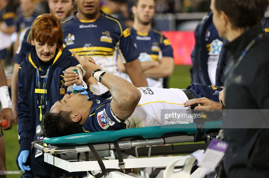 Christian Lealiifano holds up a finger while being taken off injured after the round 11 Super Rugby match between the Brumbies and the Waratahs at...
