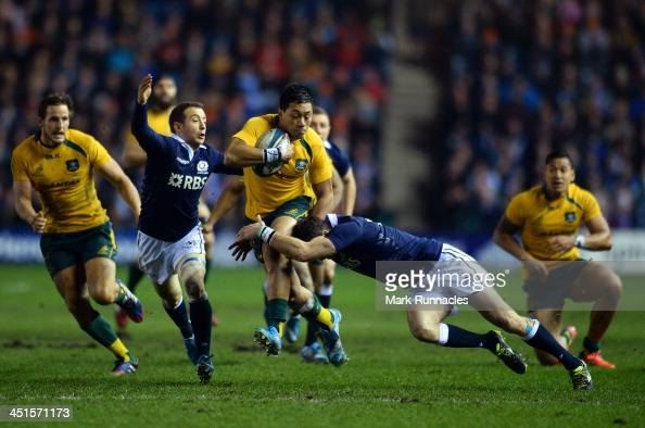 Christian Lealiifano of Australia challenges Greig Ladlaw and Tommy Seymour of Scotland to score during the Scotland v Australia Autumn International...