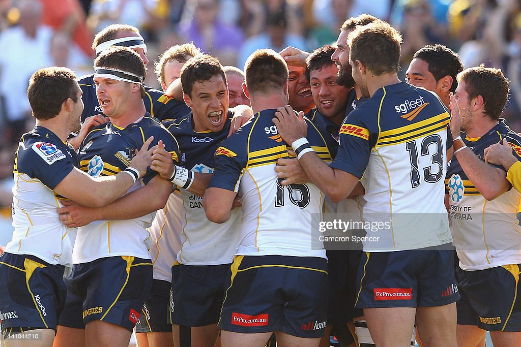 Christian Lealiifano of the Brumbies celebrates with team mates after kicking the winning penalty goal during the round three Super Rugby match...