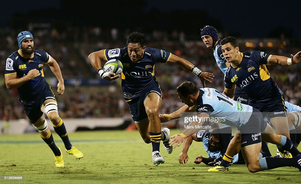 Christian Lealiifano of the Brumbies escapes a tackle to score a try during the round two NRL match between the Brumbies and the Waratahs at GIO...