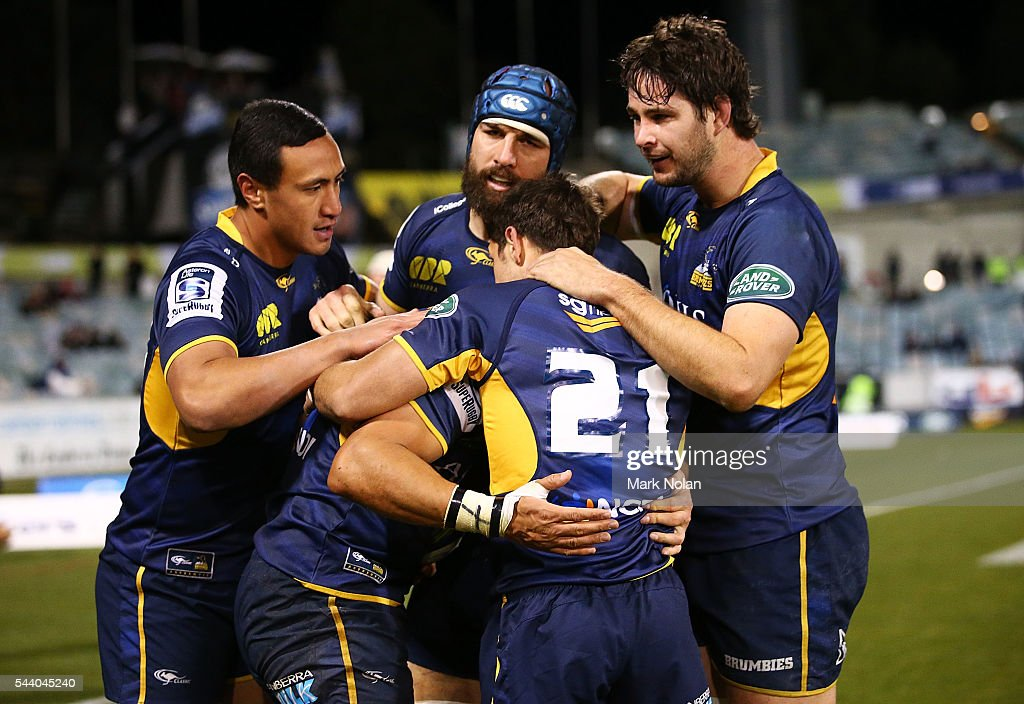 <a gi-track='captionPersonalityLinkClicked' href=/galleries/search?phrase=Christian+Lealiifano&family=editorial&specificpeople=603579 ng-click='$event.stopPropagation()'>Christian Lealiifano</a> of the Brumbies is congratulted by team mates after scoring during the round 15 Super Rugby match between the Brumbies and the Reds at GIO Stadium on July 1, 2016 in Canberra, Australia.