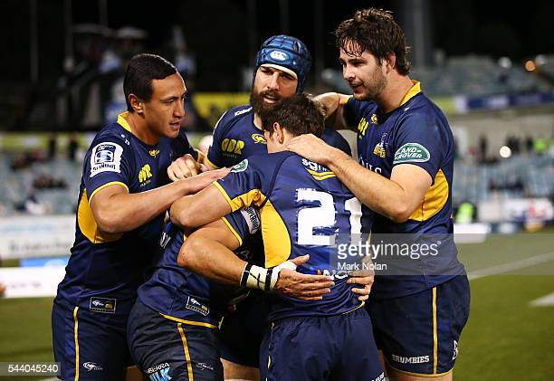 Christian Lealiifano of the Brumbies is congratulted by team mates after scoring during the round 15 Super Rugby match between the Brumbies and the...