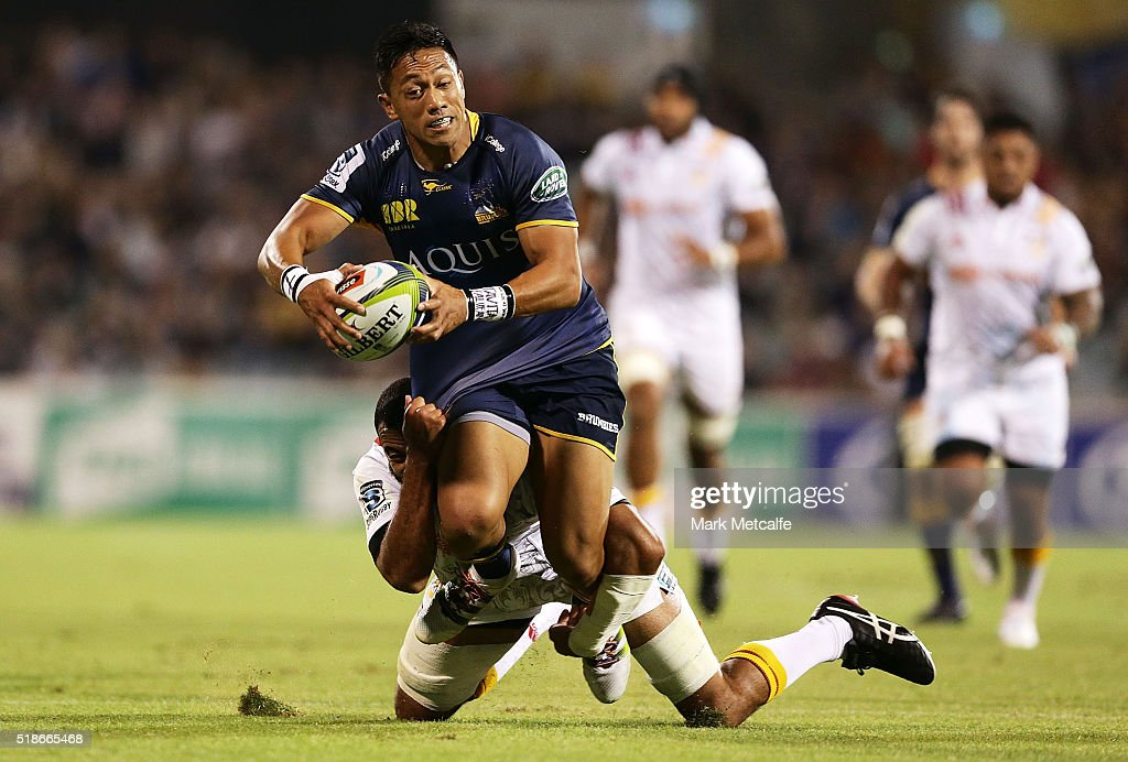 Christian Lealiifano of the Brumbies is tackled by Michael Leitch of the Chiefs during the round six Super Rugby match between the Brumbies and the...
