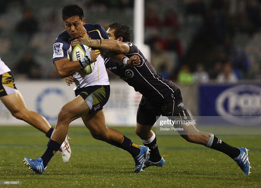 Christian Lealiifano of the Brumbies is tackled during the round 13 Super Rugby match between the Brumbies and the Sharks at Canberra Stadium on May 10, 2014 in Canberra, Australia.