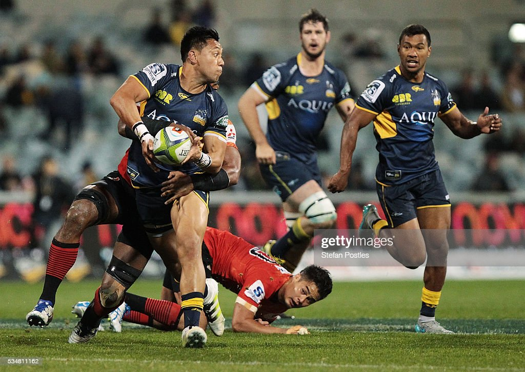 <a gi-track='captionPersonalityLinkClicked' href=/galleries/search?phrase=Christian+Lealiifano&family=editorial&specificpeople=603579 ng-click='$event.stopPropagation()'>Christian Lealiifano</a> of the Brumbies is tackled during the round 14 Super Rugby match between the Brumbies and the Sunwolves at GIO Stadium on May 28, 2016 in Canberra, Australia.