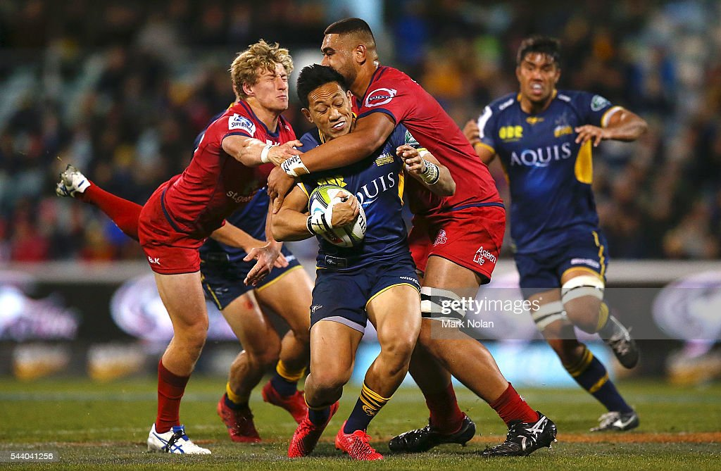 Christian Lealiifano of the Brumbies is tackled during the round 15 Super Rugby match between the Brumbies and the Reds at GIO Stadium on July 1, 2016 in Canberra, Australia.