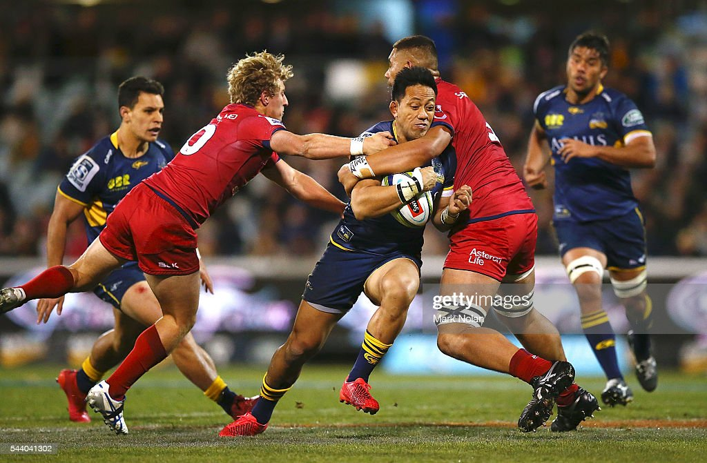 <a gi-track='captionPersonalityLinkClicked' href=/galleries/search?phrase=Christian+Lealiifano&family=editorial&specificpeople=603579 ng-click='$event.stopPropagation()'>Christian Lealiifano</a> of the Brumbies is tackled during the round 15 Super Rugby match between the Brumbies and the Reds at GIO Stadium on July 1, 2016 in Canberra, Australia.