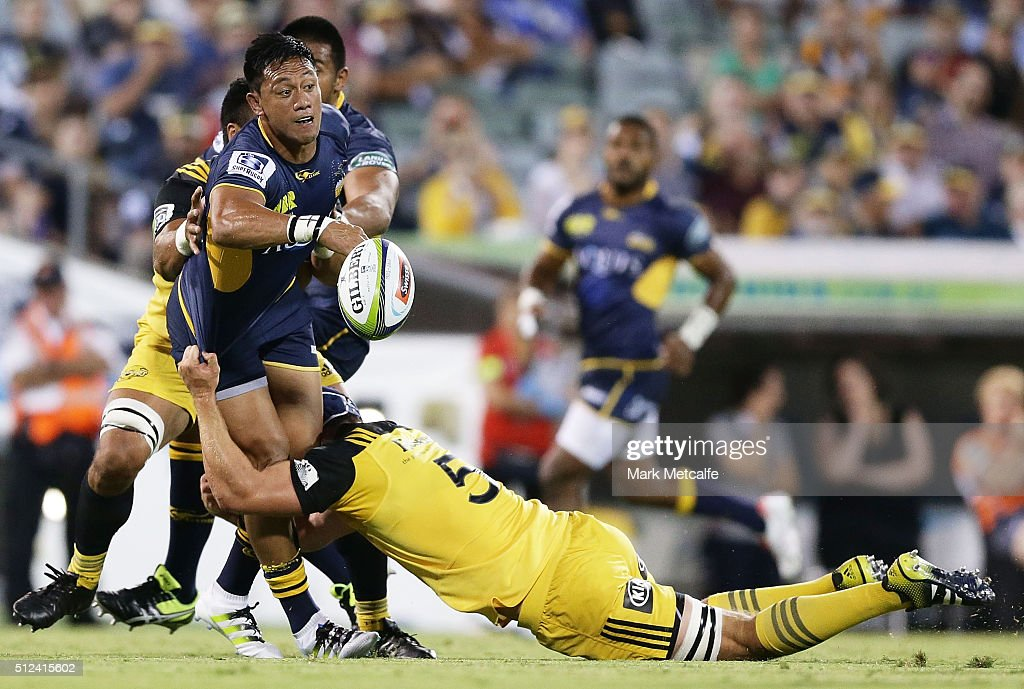 Christian Lealiifano of the Brumbies offloads during the round one Super Rugby match between the Brumbies and the Hurricanes at GIO Stadium on...