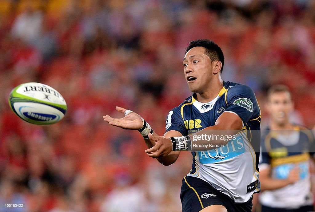 Christian Lealiifano of the Brumbies passes the ball during the round five Super Rugby match between the Reds and the Brumbies at Suncorp Stadium on...