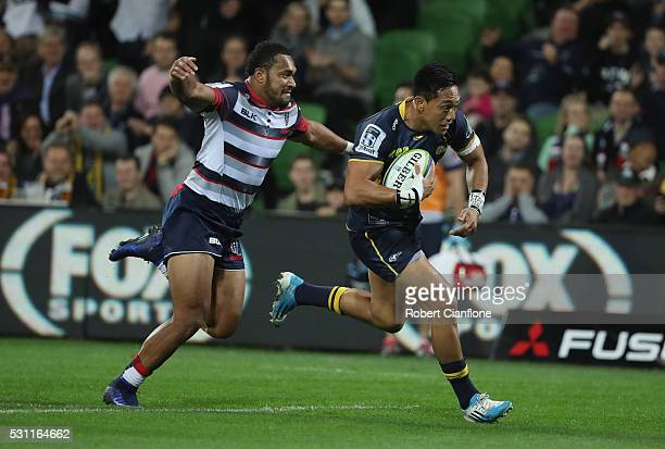 Christian Lealiifano of the Brumbies runs for the try line during the round 12 Super Rugby match between the Rebels and the Brumbies at AAMI Park on...