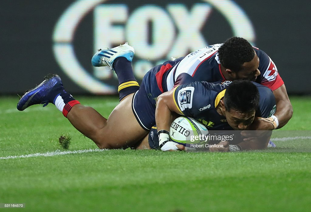Christian Lealiifano of the Brumbies scores a try during the round 12 Super Rugby match between the Rebels and the Brumbies at AAMI Park on May 13...