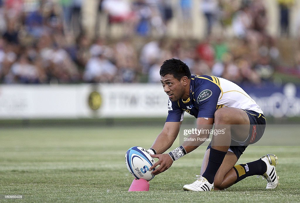 <a gi-track='captionPersonalityLinkClicked' href=/galleries/search?phrase=Christian+Lealiifano&family=editorial&specificpeople=603579 ng-click='$event.stopPropagation()'>Christian Lealiifano</a> of the Brumbies sets up to kick during the Super Rugby trial match between the Brumbies and the ACT XV at Viking Park on February 8, 2013 in Canberra, Australia.