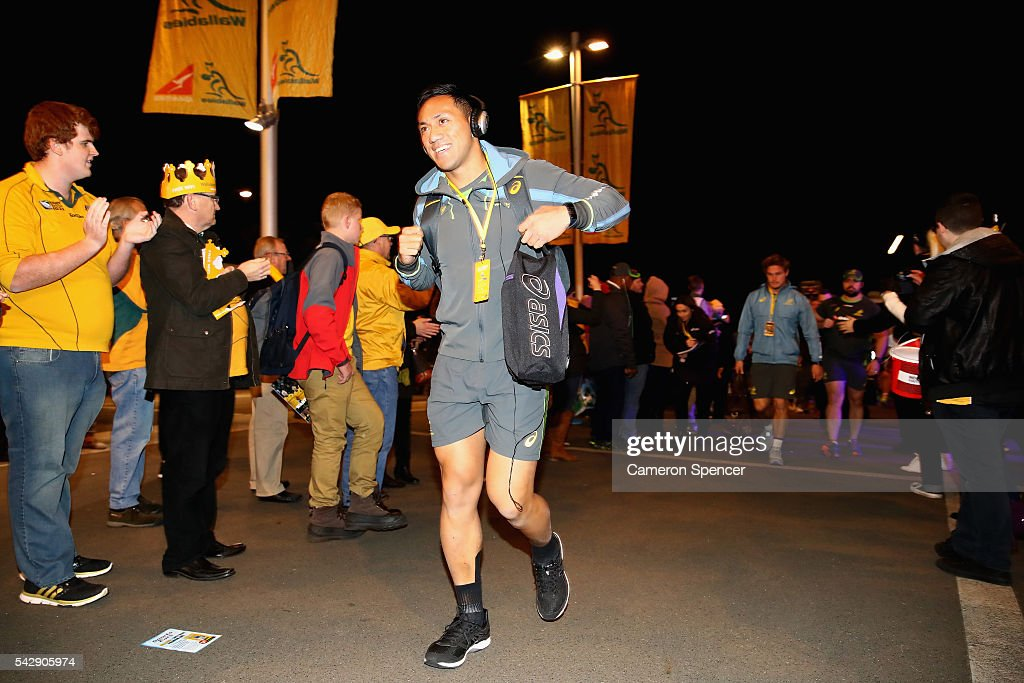 Christian Leali'ifano of the Wallabies arrives with team mates through the crowd the International Test match between the Australian Wallabies and England at Allianz Stadium on June 25, 2016 in Sydney, Australia.